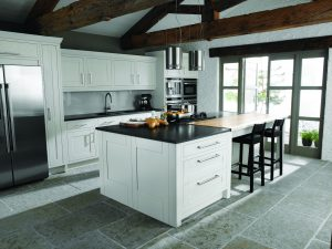 Traditional Shaker kitchen with stainless steel bar handles