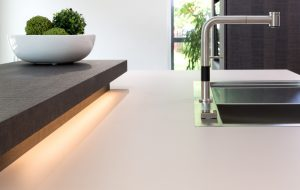 Modern kitchen LED light detail and stainless steel tap