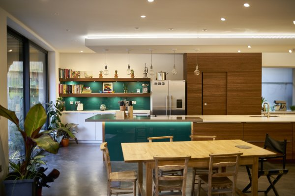 Stylish, contemporary kitchen with green glass accents